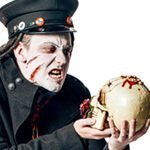 A murder mystery event actor dressed as a zombie holds a skull